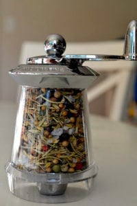 Great Island Spice Blend in a clear spice grinder