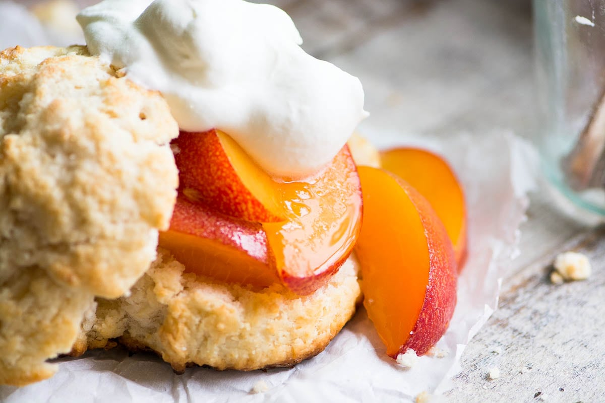 A Fresh Peach Shortcake with a dollop of whipped cream