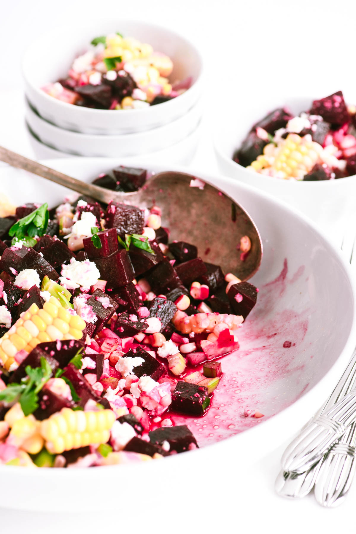 beet and corn salad, with white bowls