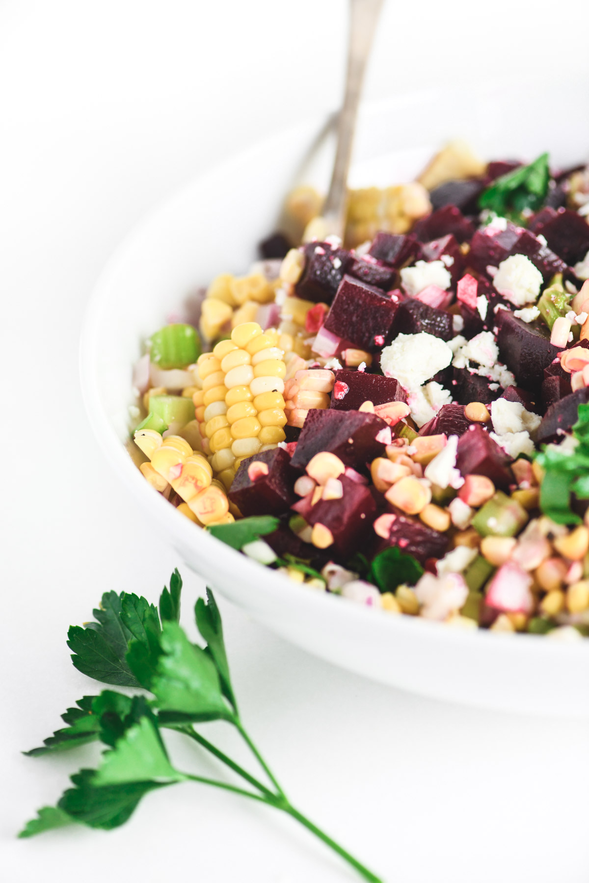 beet and corn salad in a white bowl