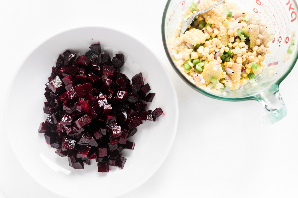 making a corn and beet salad