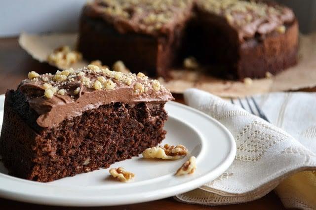 A slice of dark chocolate walnut cake