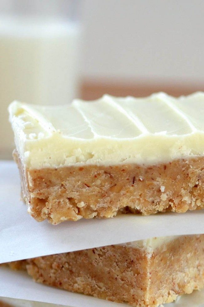 a stack of no bake white chocolate almond butter squares