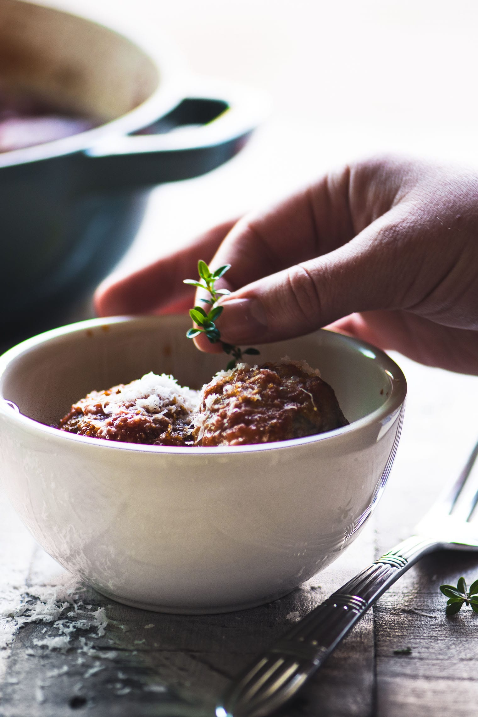 Meatballs al forno, garnished with thyme sprig