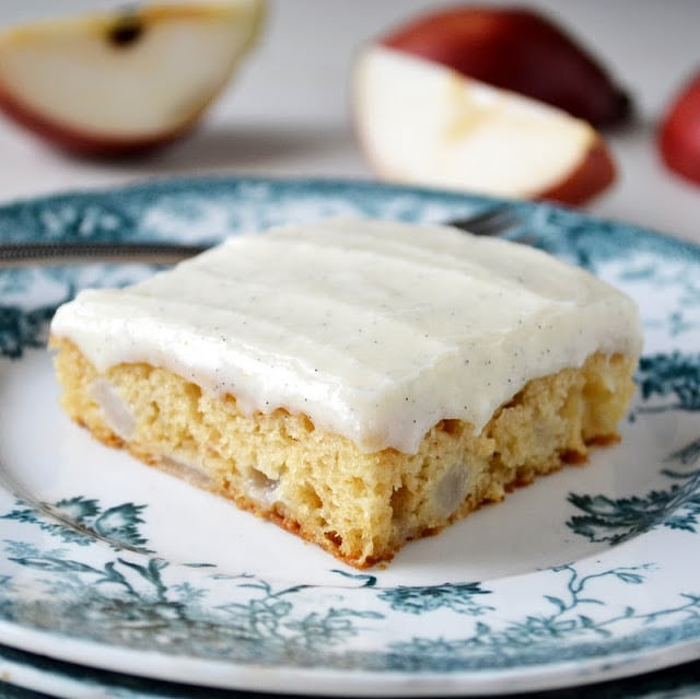 a slice of pear cake with vanilla bean frosting