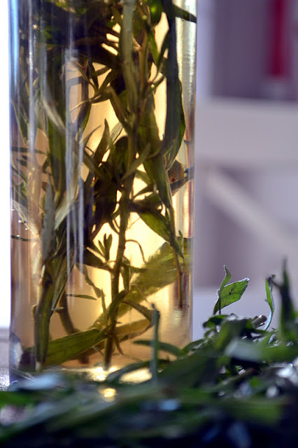 A bottle of diy tarragon vinegar