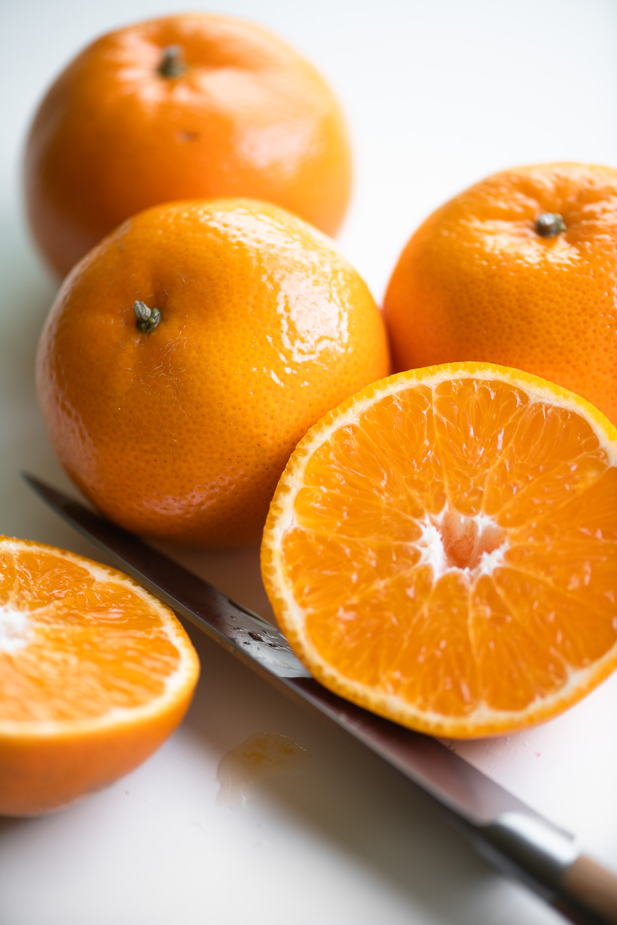 tangerines on a white surface