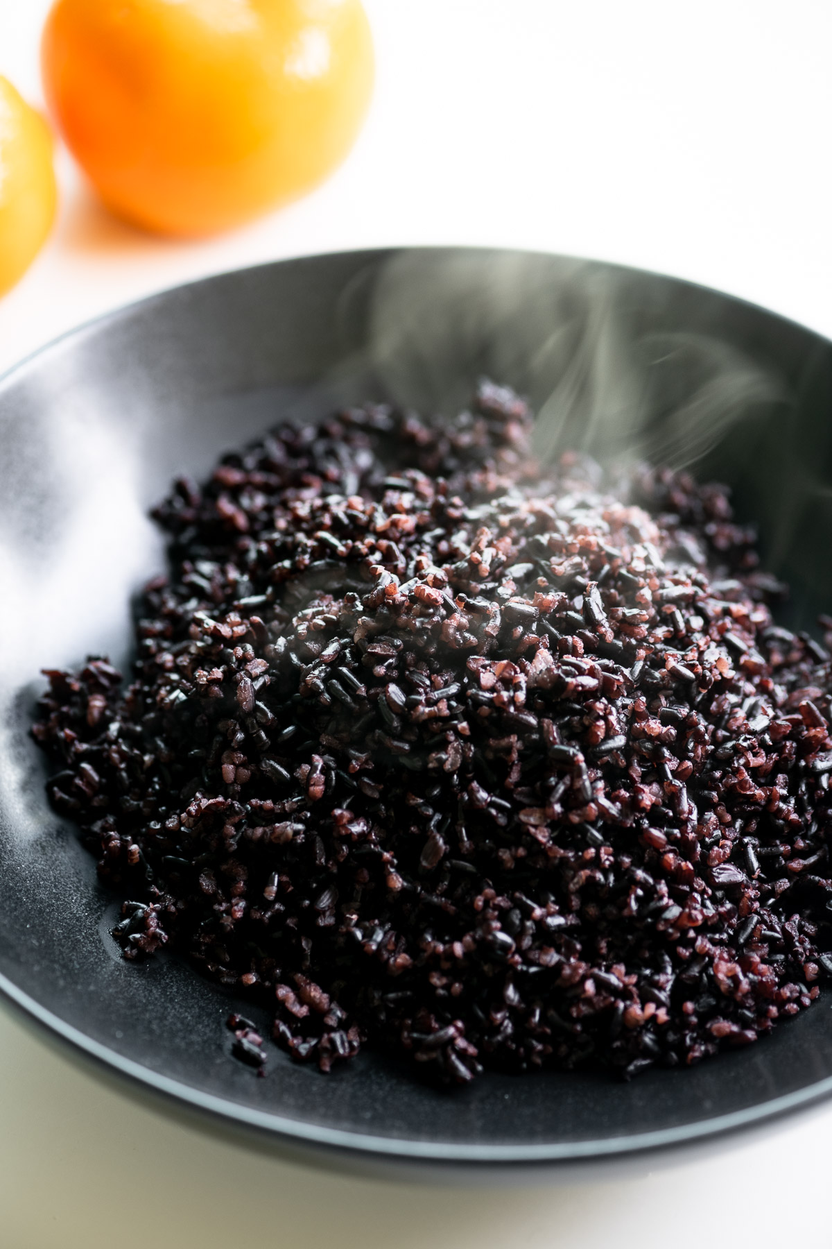 black rice steaming in a bowl