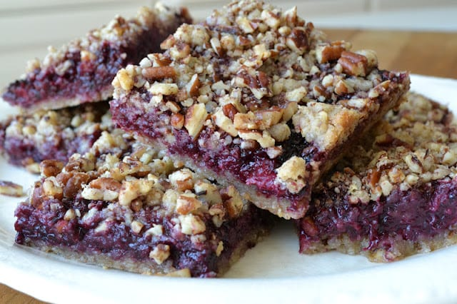 a stack of blackberry pecan crumble squares