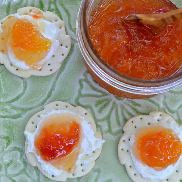 peach habanero jam with crackers and cheese