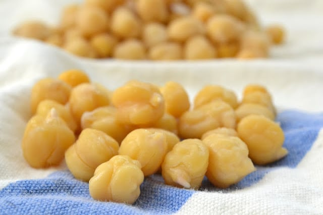 Chickpeas on a kitchen towel for Lemony Artichoke Hummus.
