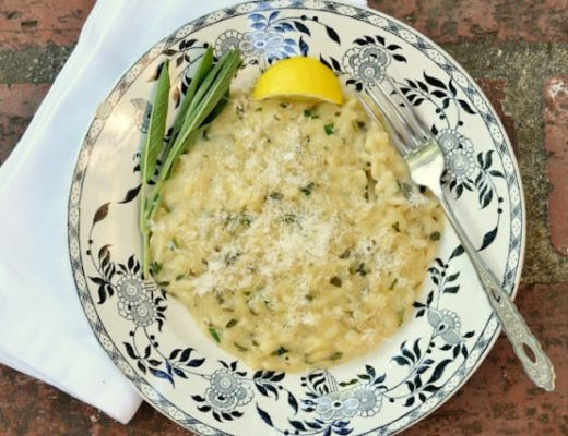 Risotto with Mixed herbs in a bowl with lemon and sage
