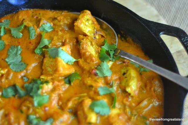chicken tikka masala cooking in a cast iron skillet