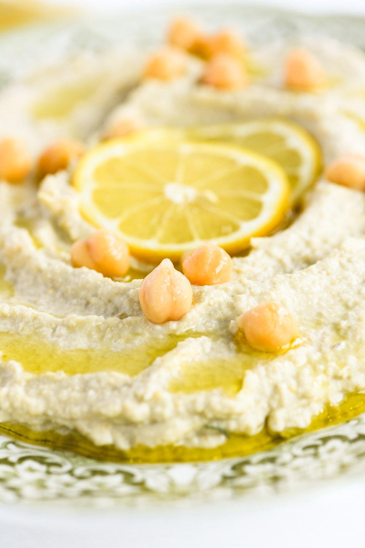 lemon artichoke hummus with lemon slices