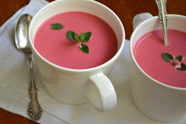 chilled beet soup in white mugs, with mint sprigs