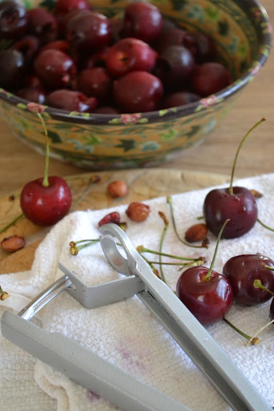 pitting cherries for old fashioned cherry coffee cake