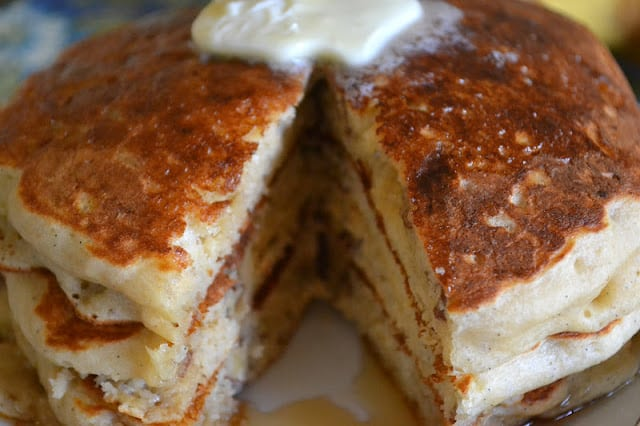 A stack of banana buttermilk pancakes with melting butter
