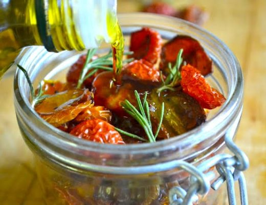 Oven dried cherry tomatoes in a mason jar with olive oil
