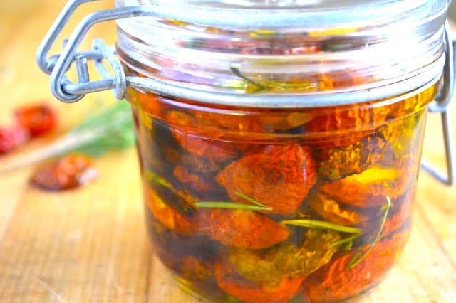How to Dry Cherry Tomatoes ~ jar of oven dried cherry tomatoes in olive oil