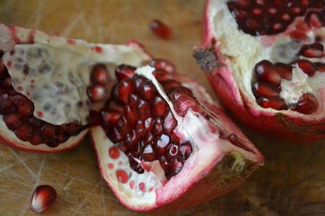 breaking open a pomegranate