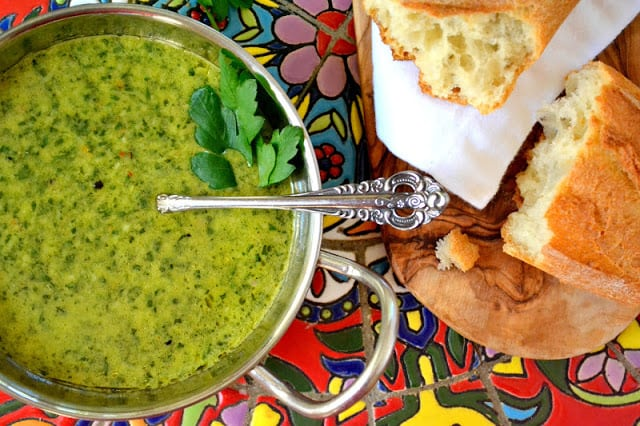 Overhead photo of a bowl of chimichurri sauce with bread.