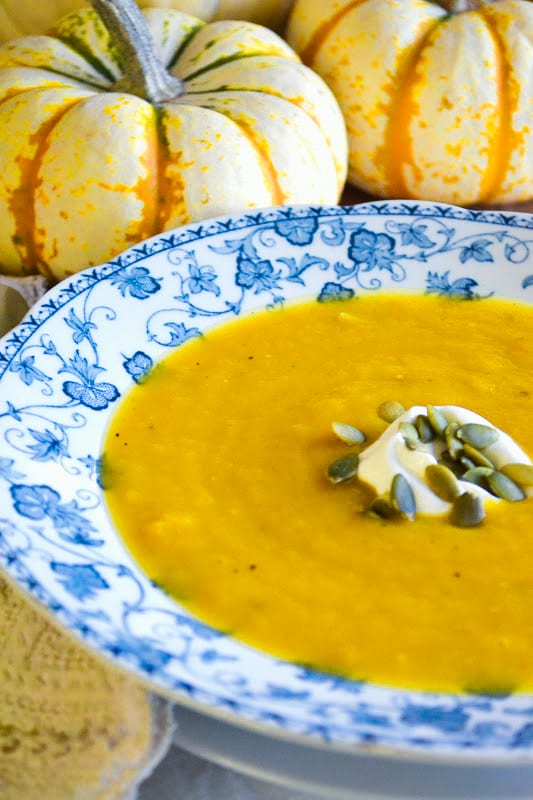 A bowl of colorful butternut squash soup