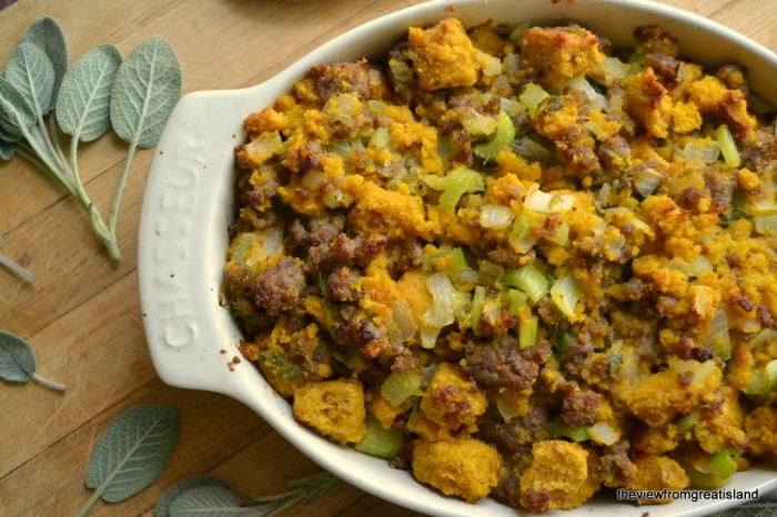 Pumpkin Cornbread Stuffing with Country Sausage and Sage in a casserole dish with sage leaves.