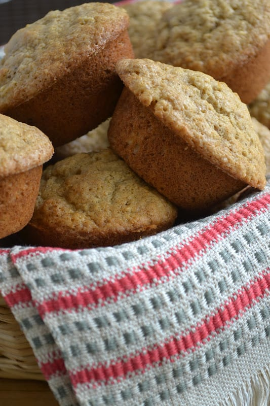 Parsnip Walnut Muffins in a basket with a tea towel