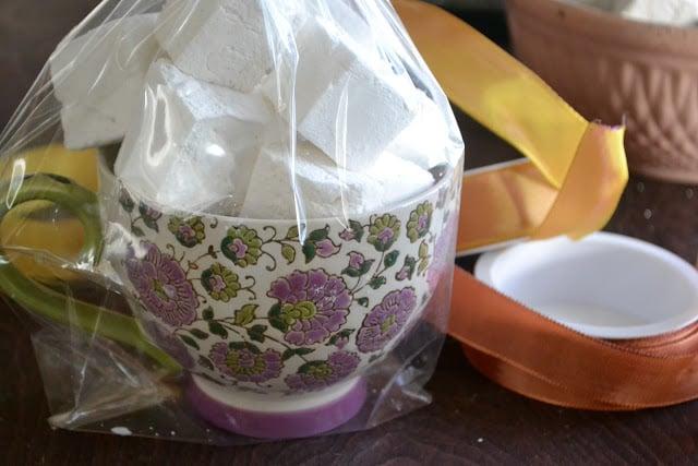 Homemade Vanilla Bean Marshmallows wrapped up in a mug