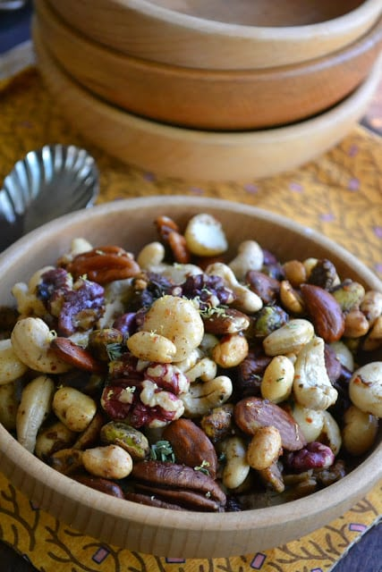 Jamaican Jerk Spiced Nuts with wooden bowls