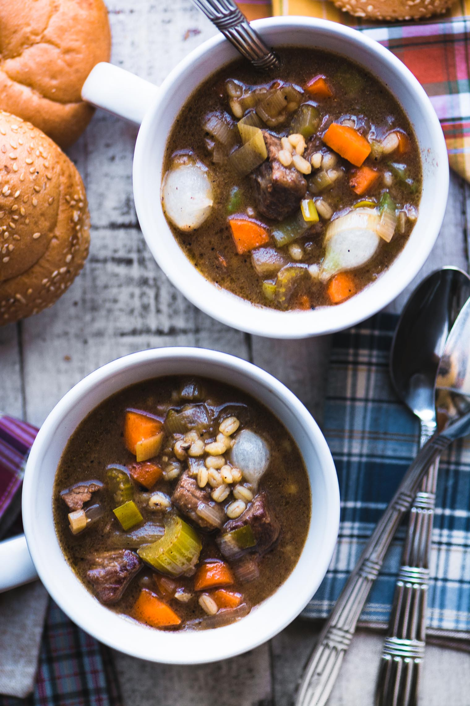 beef barley soup in white mugs