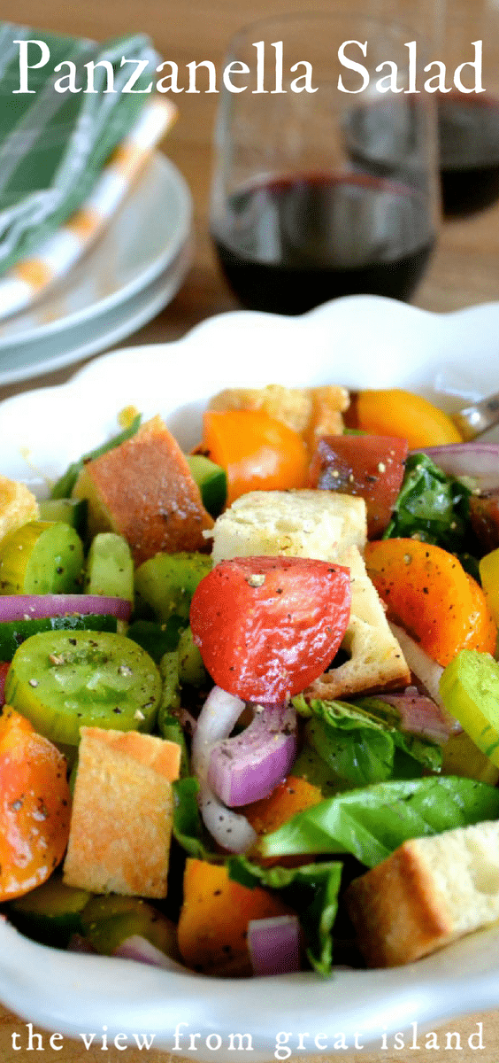 Panzanella Salad is a classic Tuscan tomato and bread salad that is the perfect way to showcase ripe colorful produce and a fabulous oil and vinegar. #salad #bread #Italian #tomato #easy #Tuscan #healthy #heirloom
