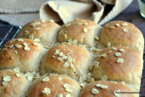 Quick Whole Grain Oat Rolls on a cooling rack