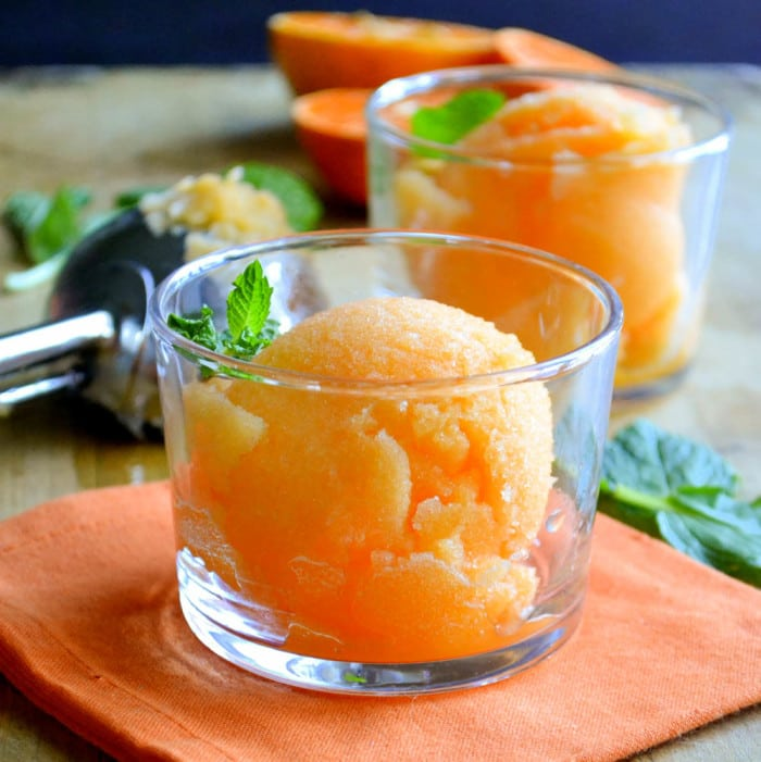 healthy one ingredient tangerine sorbet in small glass bowls with mint sprigs