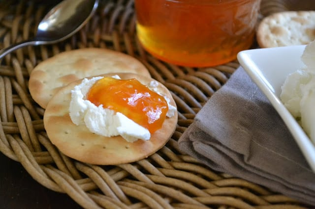 Pink grapefruit habanero jam on a cracker with cream cheese