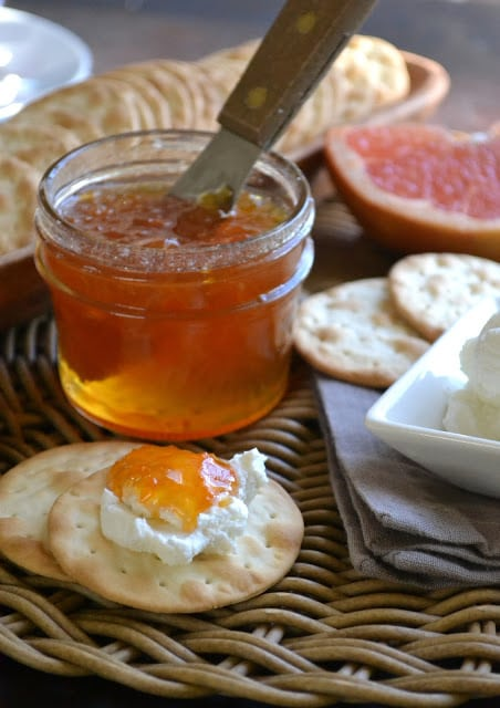 Pink grapefruit habanero jam with cream cheese and crackers