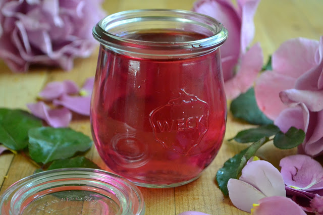 rose simple syrup in a small Weck jar