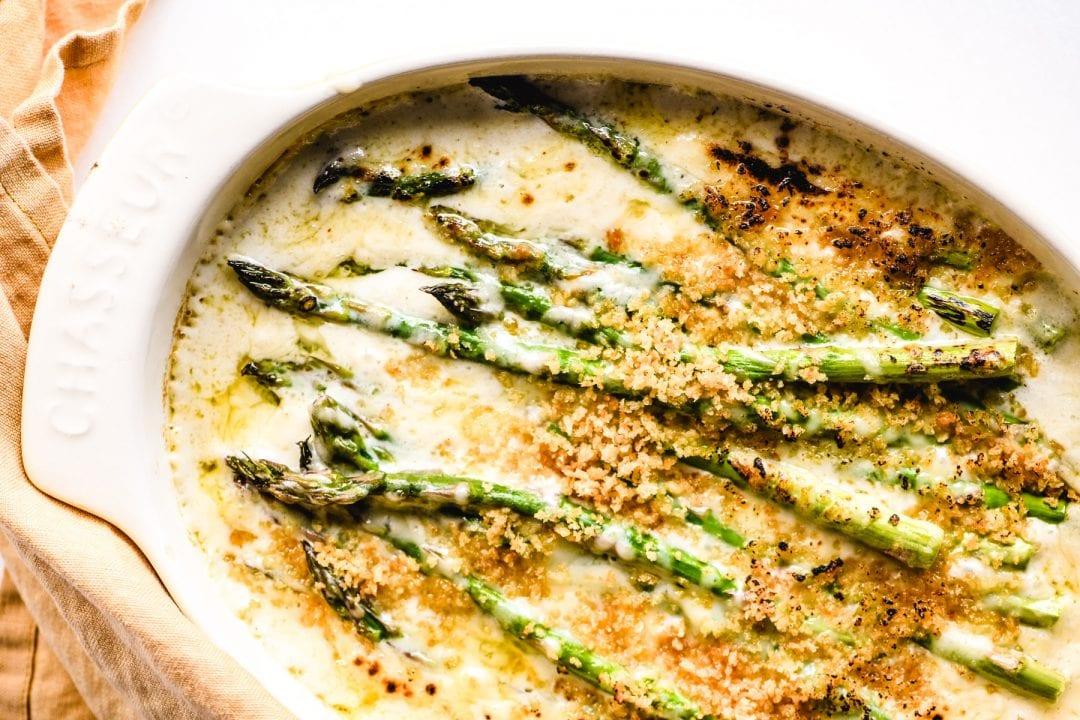 asparagus gratin in an oval baking dish
