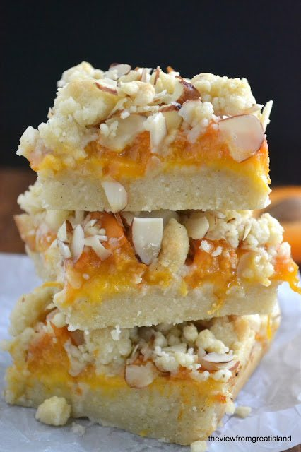Photo of a stack of Apricot Frangipane Crumble Bars.
