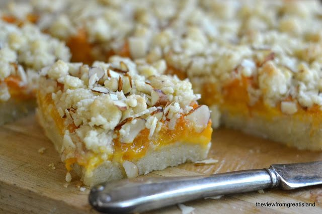 Close up photo of Apricot Frangipane Crumble Bars on a wood cutting board.