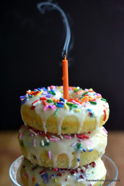 Birthday Cake Doughnuts --- a funfetti style baked doughnut fit for a celebration! theviewfromgreatisland.com