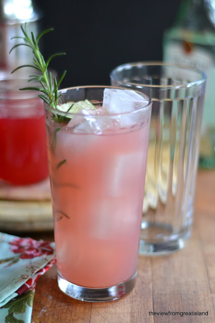 Rhubarb Spring Fling Cocktail with a rosemary garnish