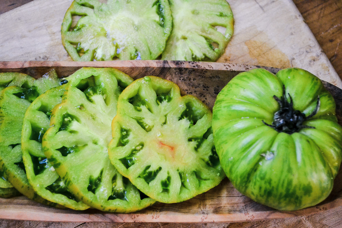 slicing green tomatoes with a mandoline
