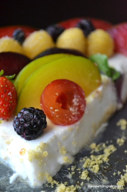 A slice of coconut panna cotta tart topped with fresh fruit