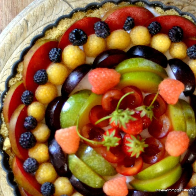 panna cotta tart topped with colorful fresh fruit