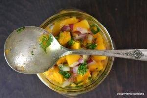 Papaya Salsa in a jar with spoon