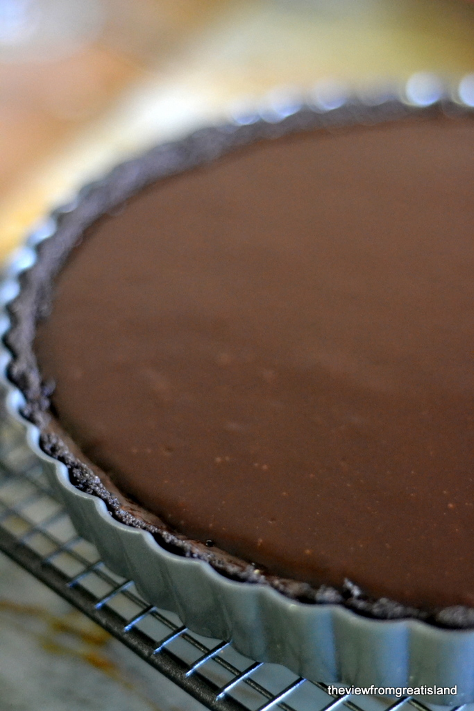espresso ganache tart cooling on a rack