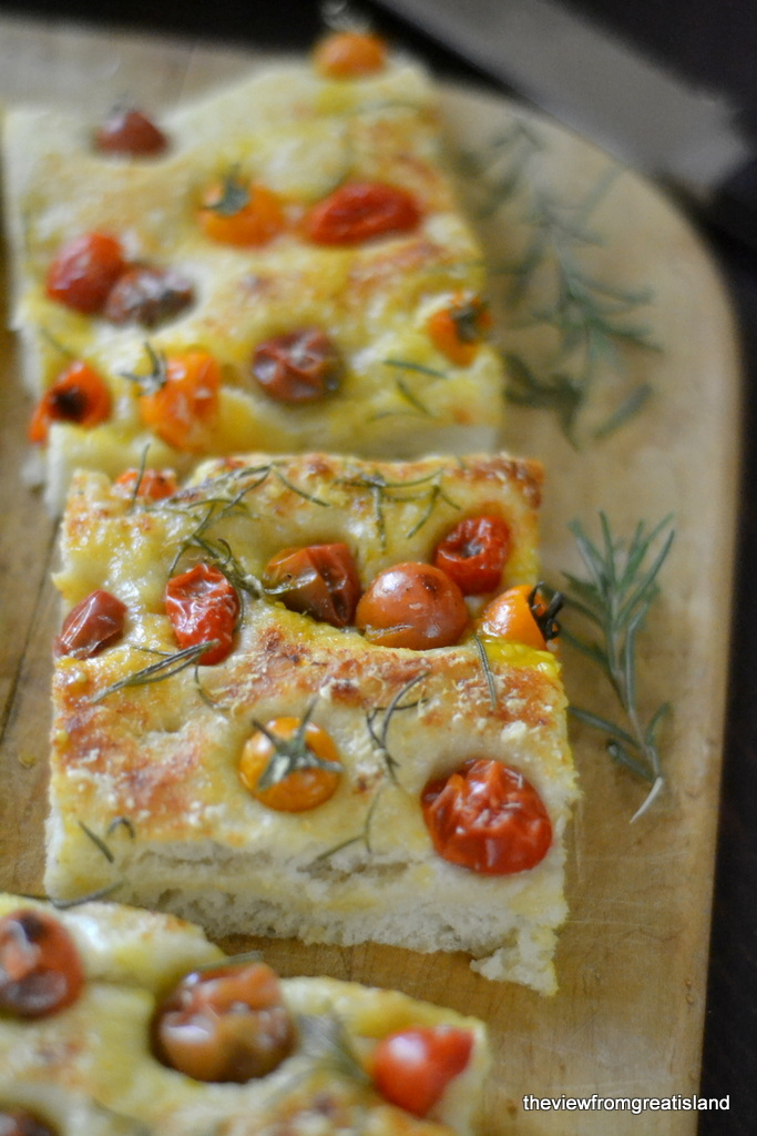 Summer tomato focaccia on a cutting board