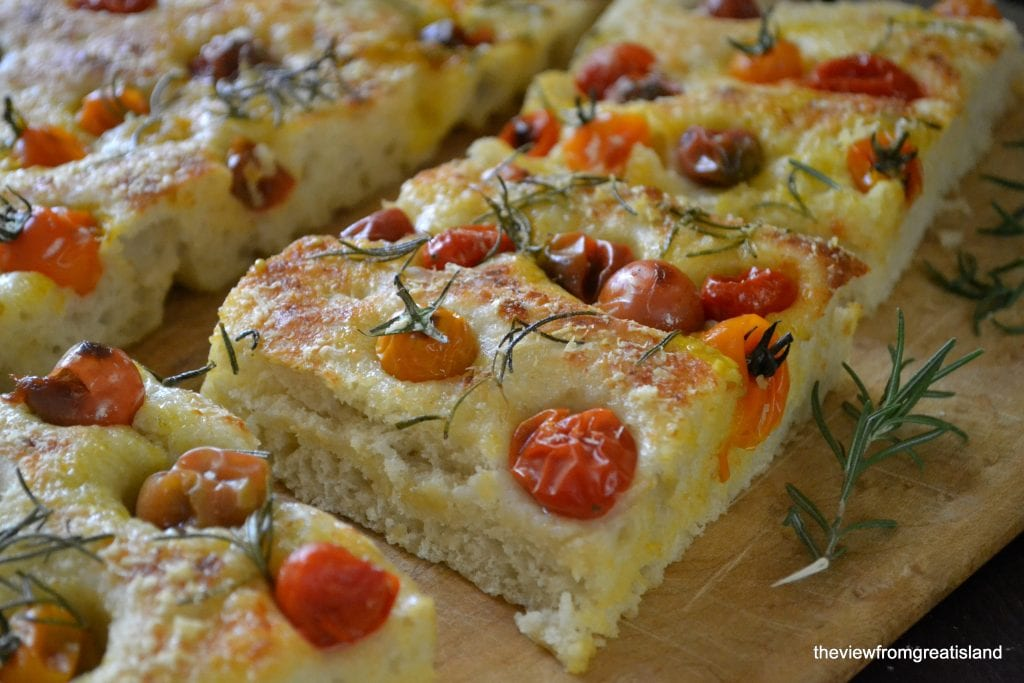 summer tomato focaccia topped with cherry tomatoes and fresh rosemary