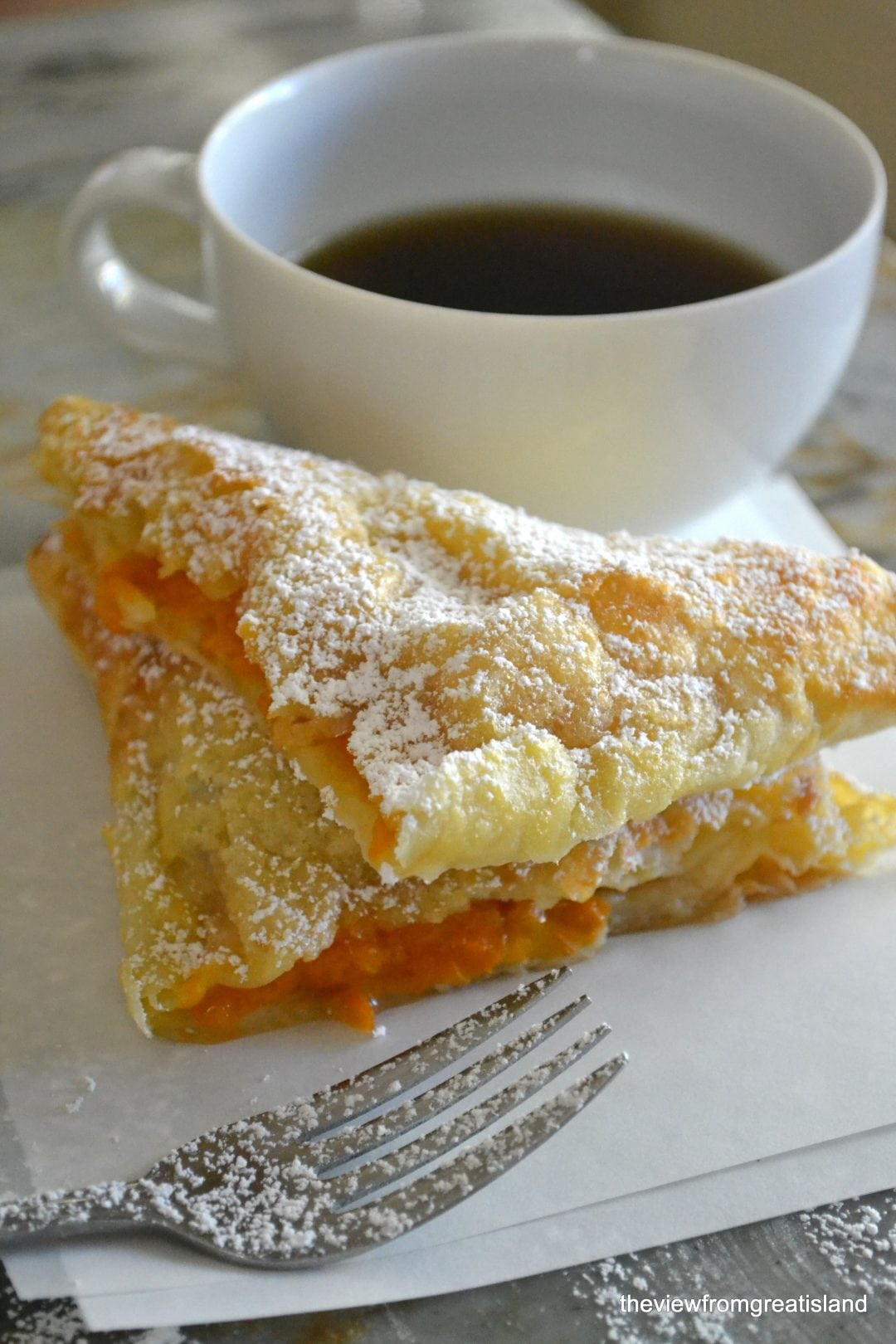 Apricot Turnovers with a cup of coffee and a fork